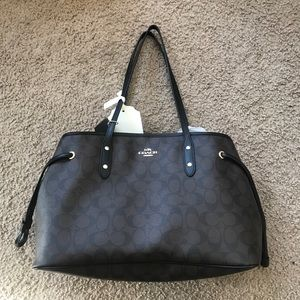 Coach PVC drawstring brown purse new with tags.